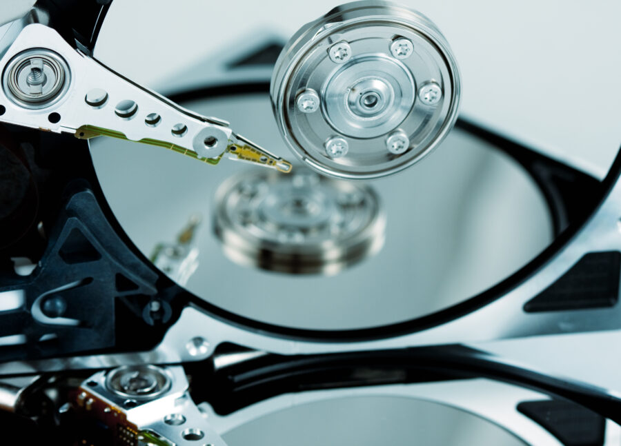 Close Up Of Hard Drives Needle And Platter With Reflection